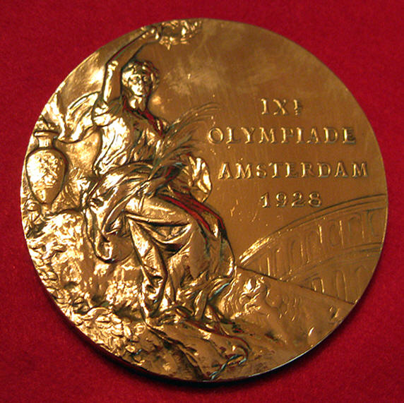 The front of the 1928 Amsterdam Olympic medal.