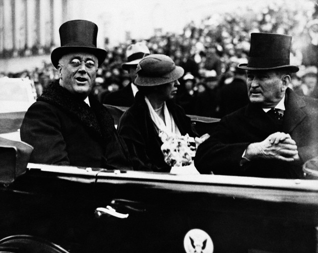 Franklin Delano Roosevelt wearing his top hat in the Presidential limo